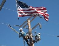 Line workers with American flag
