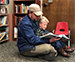 Man and child reading in Friends bookstore